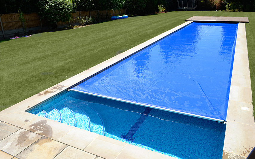 Swimming pool safety covers lagoon pools designing for Bespoke swimming pools